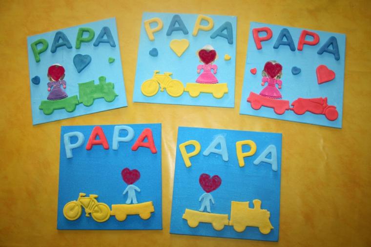 Cartoline di colore blu, disegni di macchine, scritte per il giorno del papà