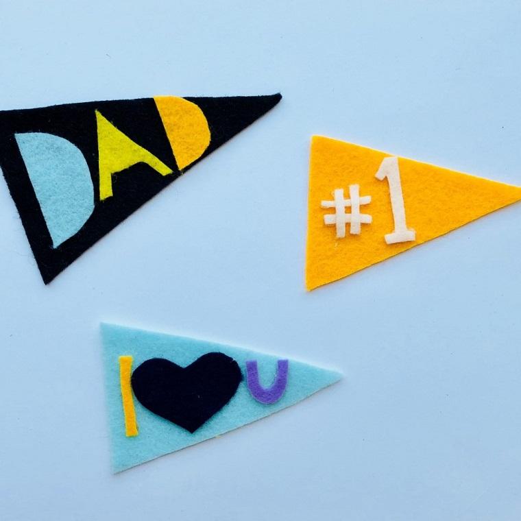 Lavoretti per il papà fai da te, triangoli colorati di feltro, scritte di feltro