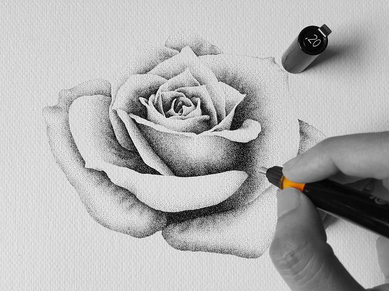 Foglio bianco ruvido, disegno di una rosa, tecnica con i puntini