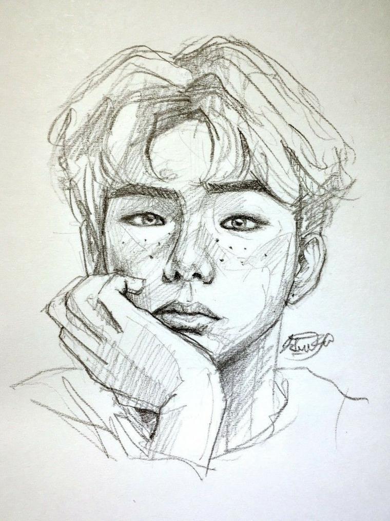 Ritratto di un ragazzo, abbozzo a matita, disegno su foglio ruvido