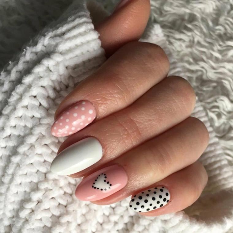Unghie a mandorla, accent nail disegno cuore, maglione di lana bianco