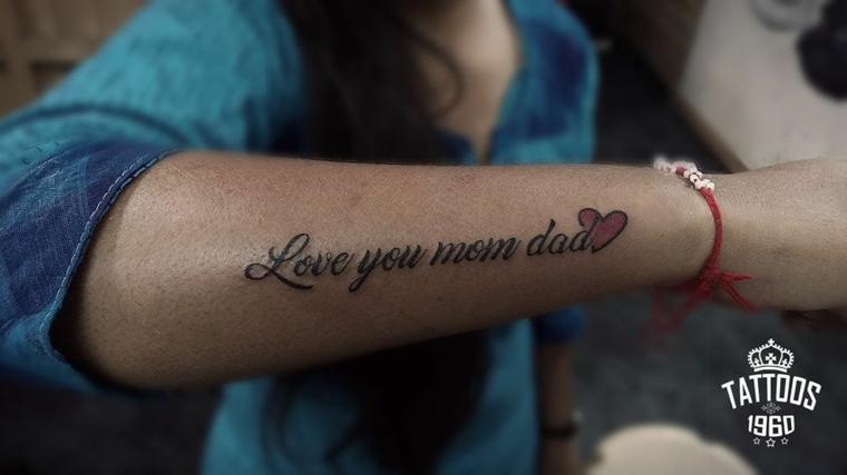Tatuaggi femminili eleganti, tattoo sull'avambraccio, tatuaggio con scritta