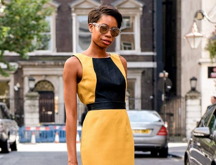 Taglio corto asimmetrico, capelli donna di colore castano, vestito donna colore giallo