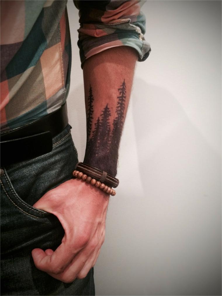 Tatuaggi significati profondi, tatuaggio sull'avambraccio, tattoo alberi nella foresta