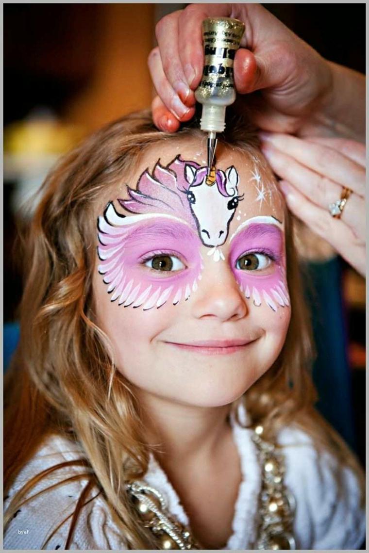 Disegno viso su una bimba, travestimento da unicorno, trucco bimba per Halloween
