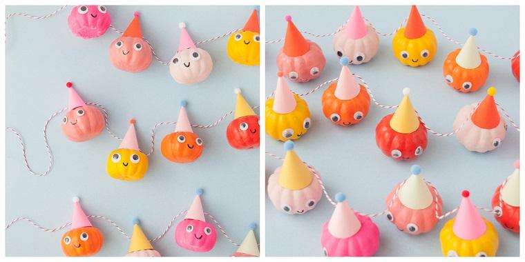 Lavoretti creativi per bambini Halloween, ghirlanda con zucche, zucche colorate e decorate