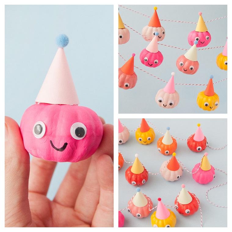 Ghirlanda con mini zucche, zucca finta colorata di rosa, cappellino con pom pom, lavoretti Halloween