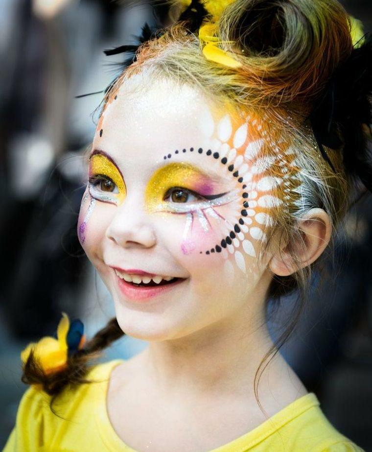 Trucchi Halloween facili, bimba con ombretto giallo, disegno puntini neri e foglie bianche