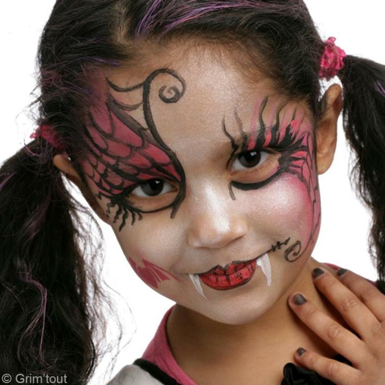 Bimba truccata da strega, travestimento per Halloween, disegni sul viso bimba