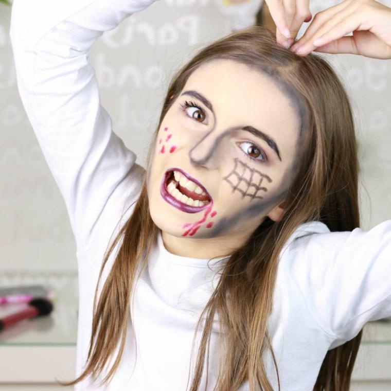 Bimba truccata come zombie, trucco viso ragazzina, faccia paurosa per Halloween