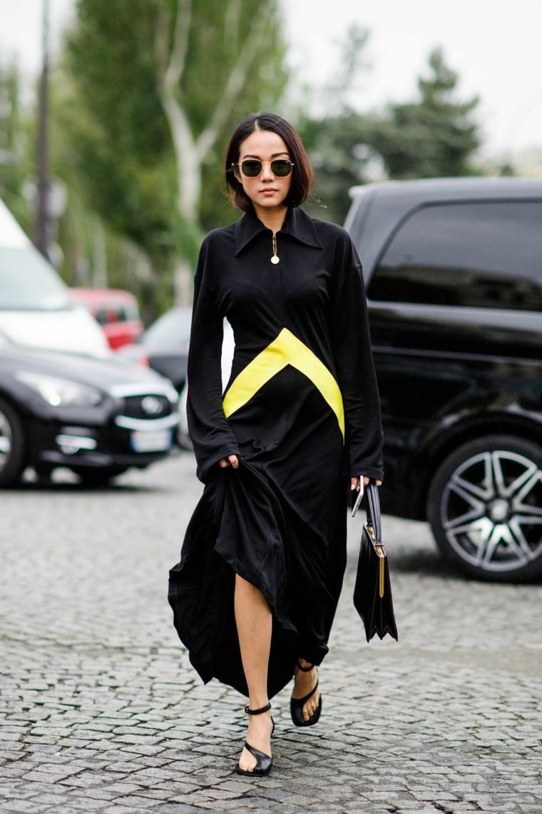 Vestiti lunghi con spacco, abito nero e giallo, ragazza che cammina, occhiali da sole rotondi
