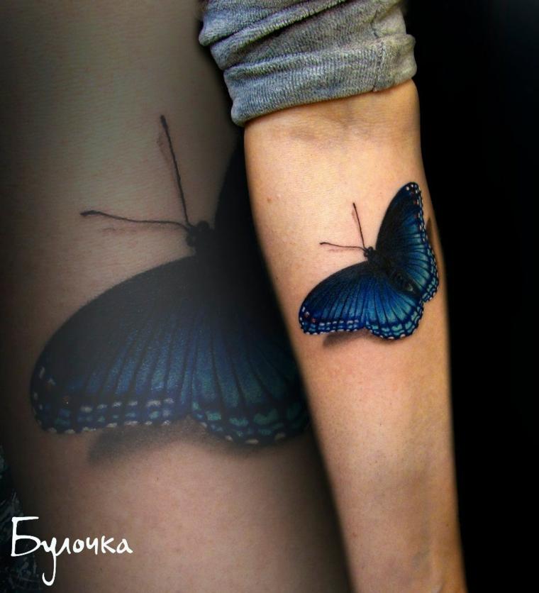 Disegni farfalle colorate, disegno tattoo di una farfalla sull'avambraccio di una donna