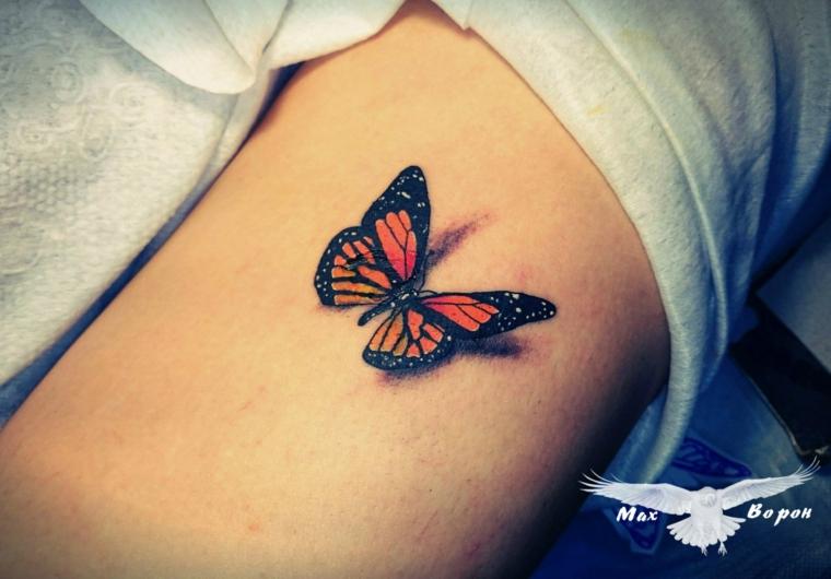 Farfalla significato, disegno colorato di arancione, tatto sul braccio di una donna