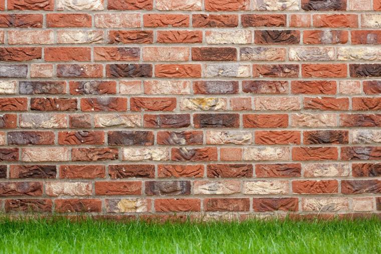 Foto di un muro pietre a vista, immagine per il screen del computer