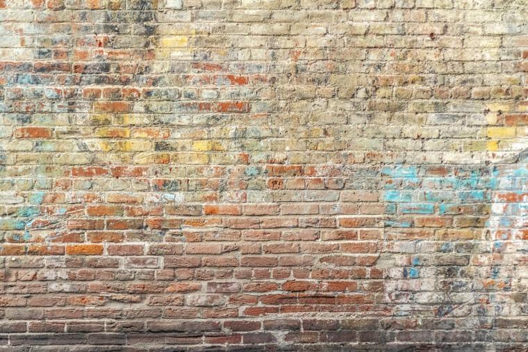 Foto di un muro con mattoni a vista, muro con disegni, immagine per lo screen del computer