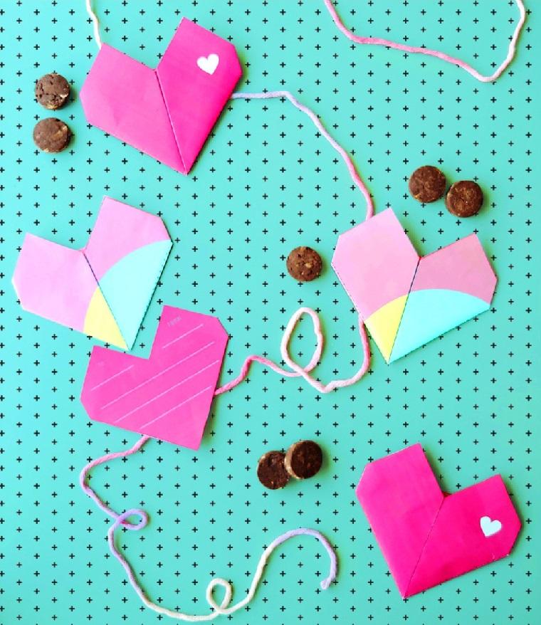 Origami facili per bambini, ghirlanda cuori origami con fogli di carta colore rosa