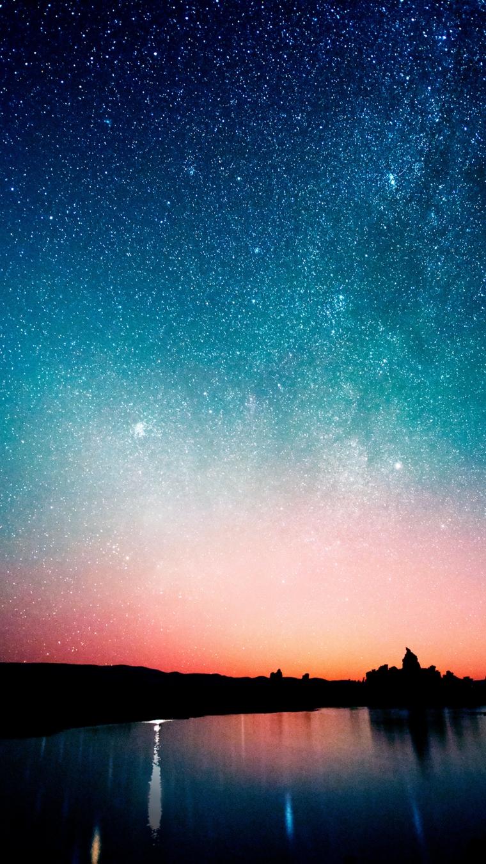 Disegno di un lago e cielo stellato, gli sfondi più belli del mondo