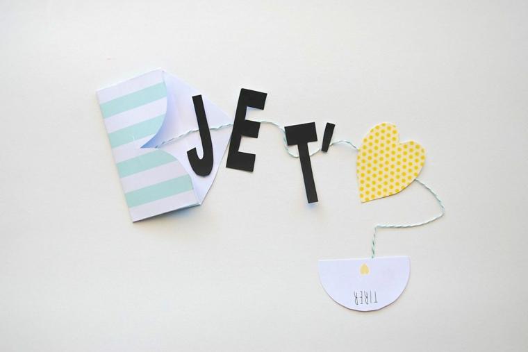 Idea regalo per 14 febbraio, bigliettino con scritta a ghirlanda con cuore di carta