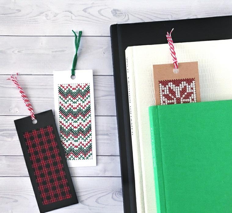 Libri con copertina rigida, segnalibro con cuciture e filo di lana colorato