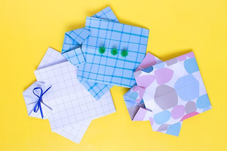 Cartolina con fogli colorati piegati, auguri per la festa del papà, decorazione cartolina con fiocco e pompon