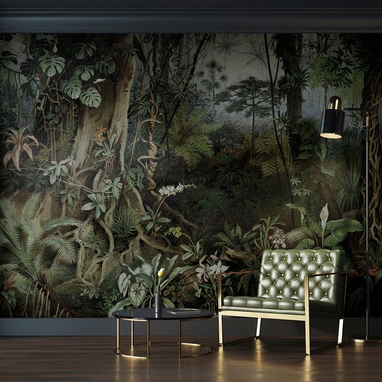 Zona living con poltrona di pelle e tavolino basso, parete con fotomurale disegno colorato
