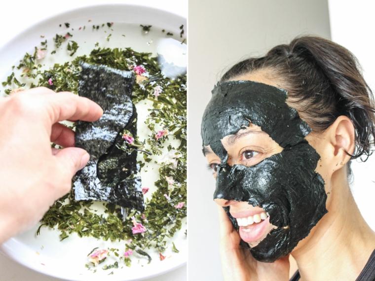 Donna con una maschera di colore nero sul viso, piatto con erbe secche e alghe nere