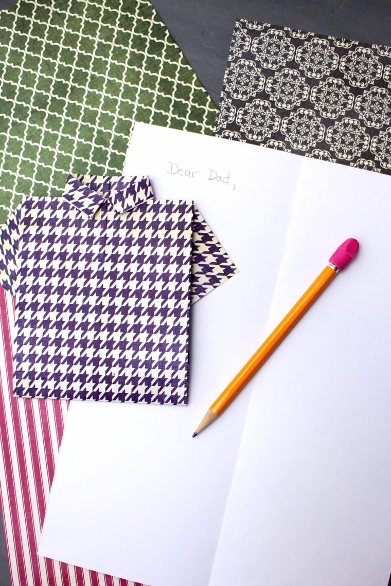 Foglio bianco con scritta a matita, camicia cartolina origami, auguri per la festa del papà