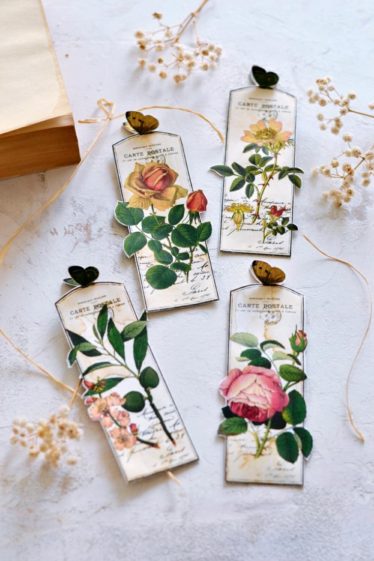 Segnalibri ritagliati con foto vintage di rose, fiori secchi di un tavolo