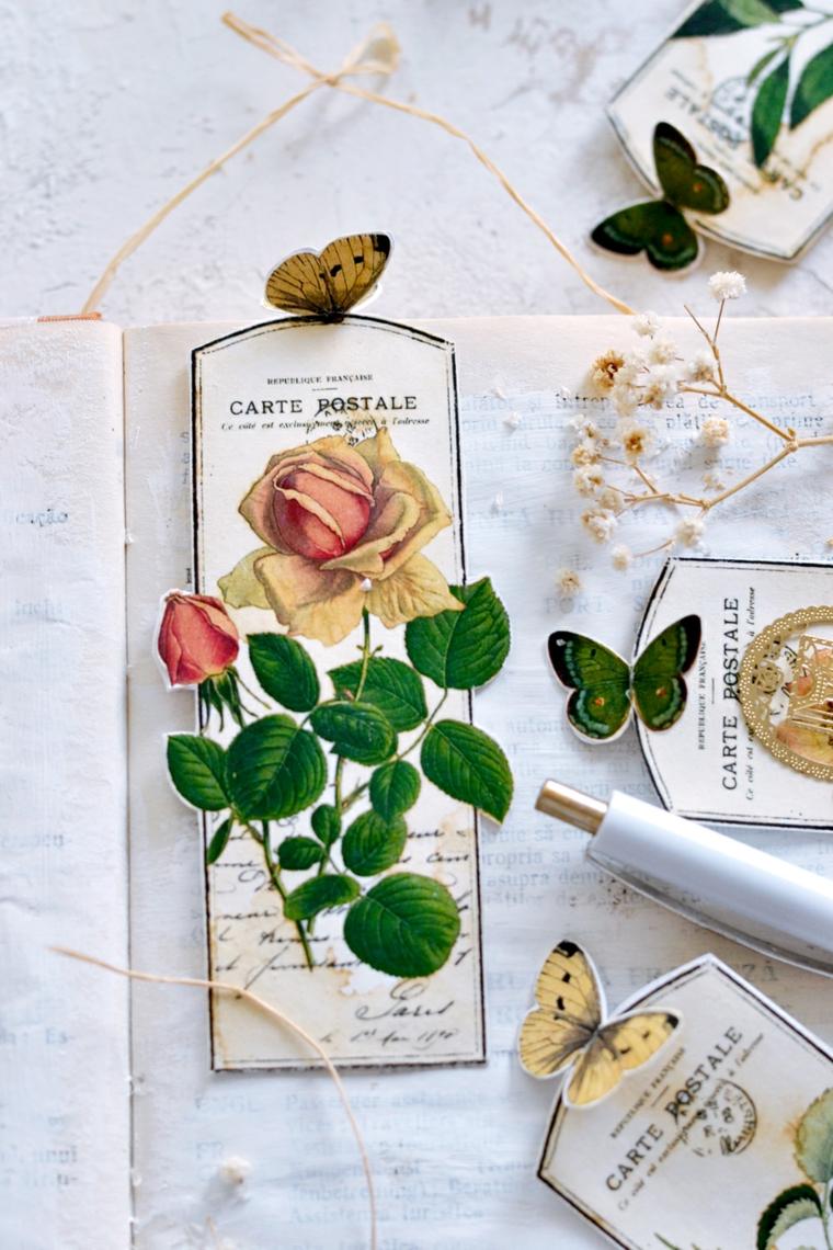 Segnalibri ritagliate con foto vintage di rose, penna su un libro aperto