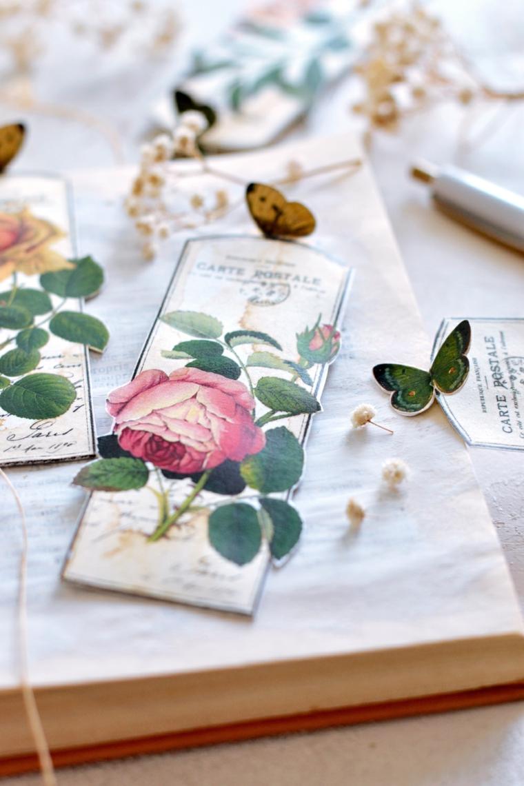 Segnalibro su un libro aperto, segnalibro ritagliato con foto vintage di fiori e farfalle