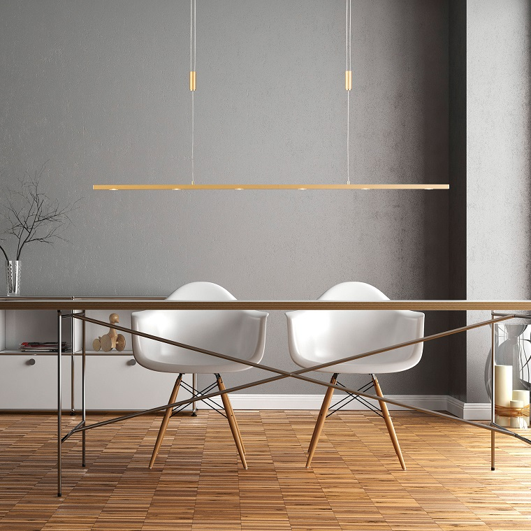 Sala da pranzo con tavolo di legno e due sedie, illuminazione interni con faretti a led