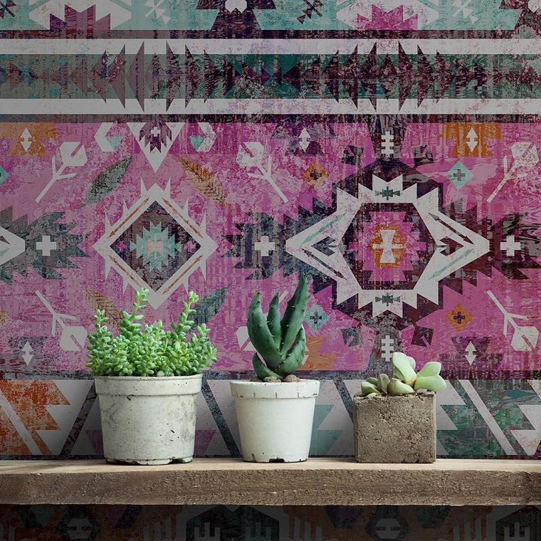 Mensola di cemento con vasi di piante grasse, parete con poster fotomurale