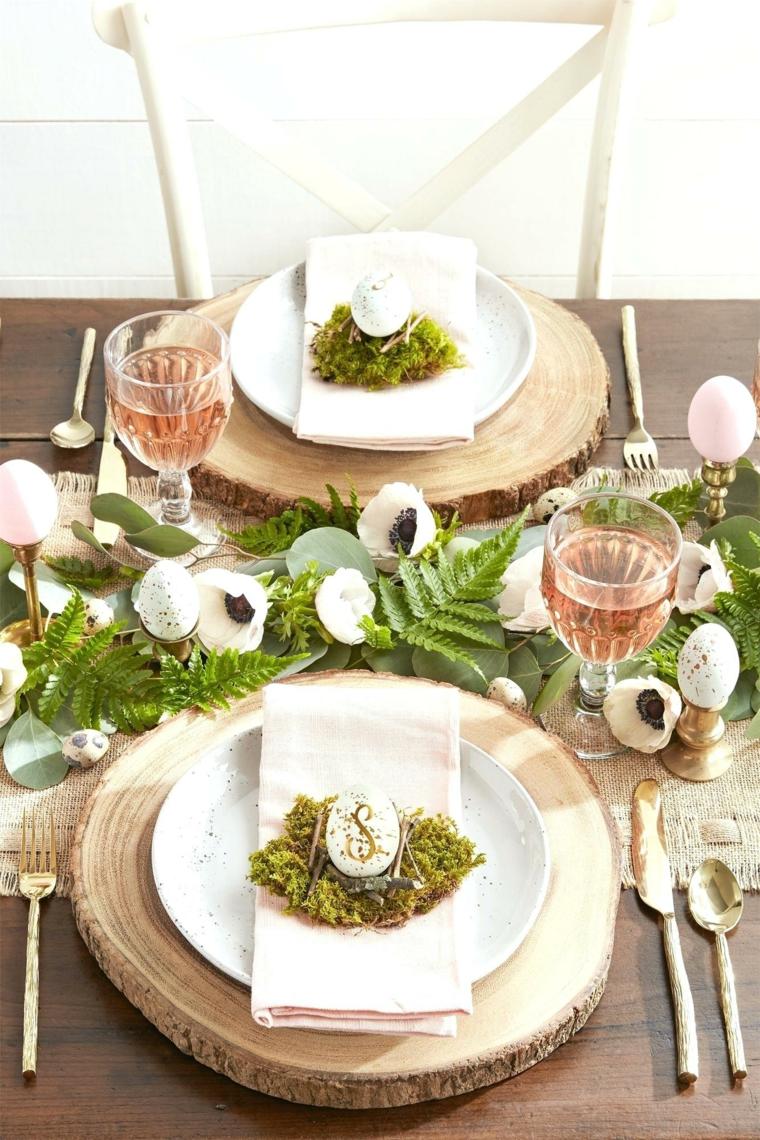 Auguri di buona Pasqua immagini, foto di una tavola con centrotavola e segnaposto pasquali