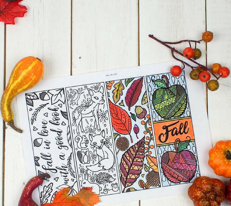 Foglio con disegno di foglie autunnali, foto di un disegno e zucche e foglie autunnali