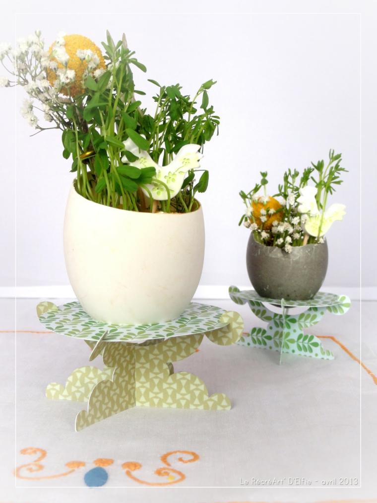 Foto di due vasi di fiori in gusci di uova, foto con sfondo di colore bianco