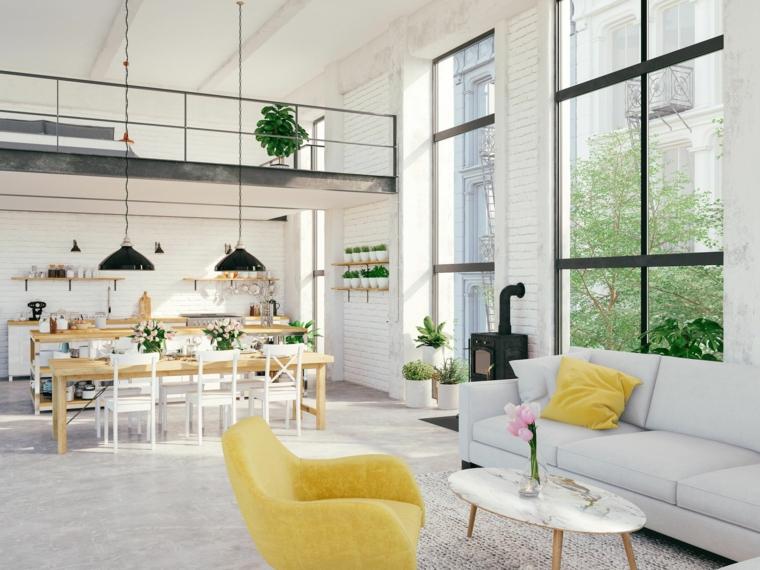 Case moderne interni open space, divano con tavolino basso, appartamento con soppalco