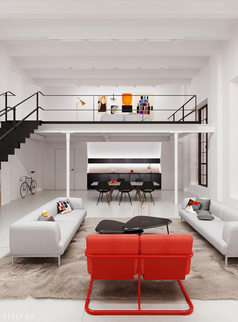 Open space con soppalco, soggiorno con due divani, cucina con tavolo da pranzo e sedie