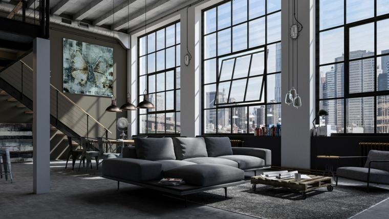 Appartamento open space significato, soggiorno con divano grigio, tavolo in pallet
