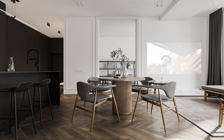 Arredare un loft, cucina e sala da pranzo insieme, tavolo rotondo con sedie, pavimento in legno parquet