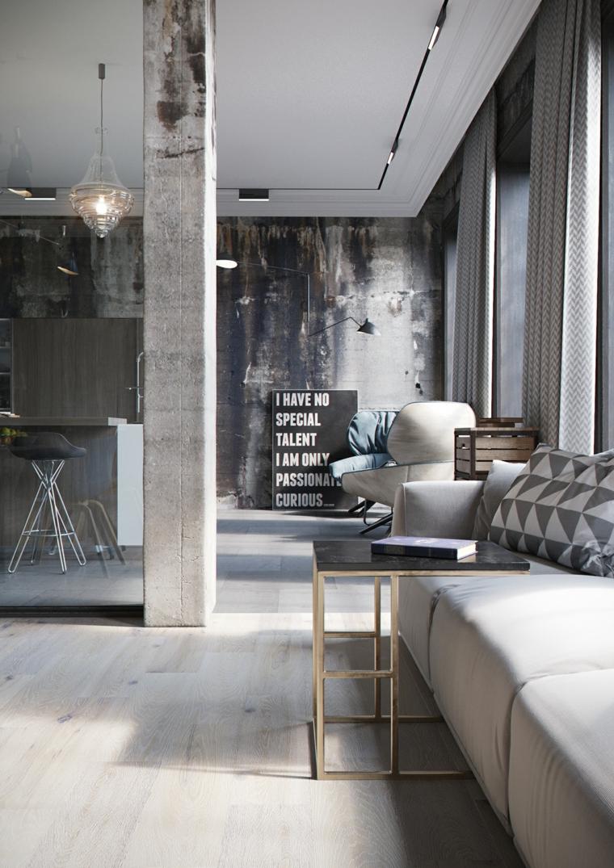 Arredare un open space, soggiorno con divano e tavolino, cucina con isola centrale
