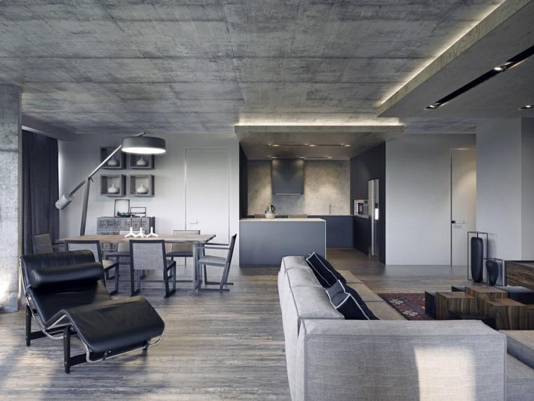 Arredare un open space, soggiorno con divano grigio, cucina e sala da pranzo insieme