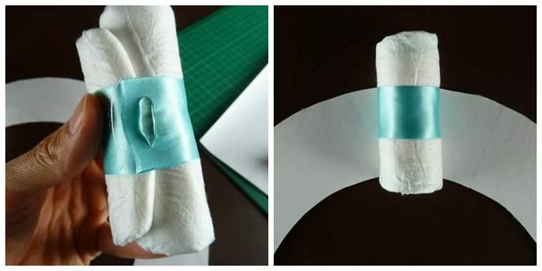 Avvolgere nastro azzurro un pannolino, come fare un fiocco grande di stoffa