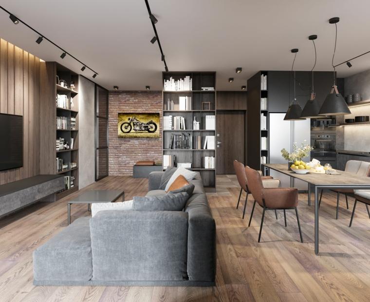 Appartamento open space significato, soggiorno con divano grigio, cucina con tavolo da pranzo