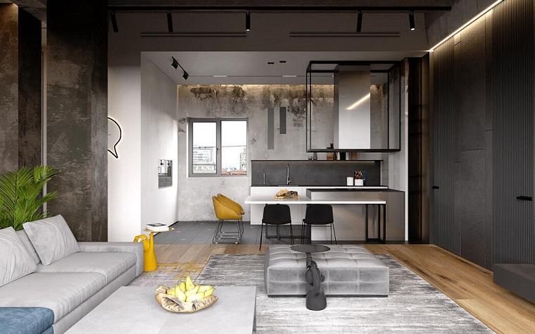 Appartamento open space, cucina e soggiorno insieme, soggiorno con divano e tavolino