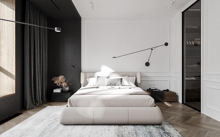 Camera da letto in stile loft, come arredare un loft open space, letto con testata in pelle beige
