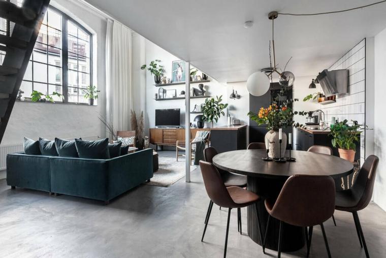 Case moderne interni open space, sala da pranzo con tavolo rotondo e sedie