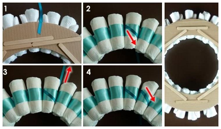 Come realizzare fiocchi nascita da esterno, tutorial con pannolini avvolti in nastro azzurro