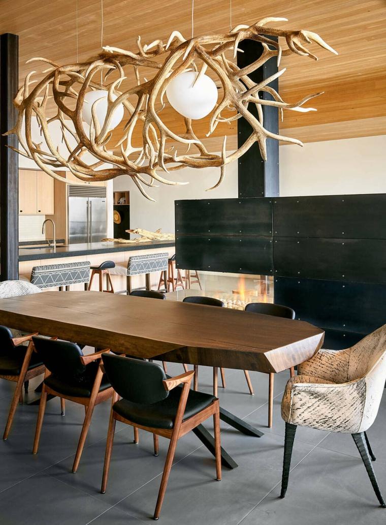 Come arredare un loft open space, sala da pranzo con tavolo di legno e sedie