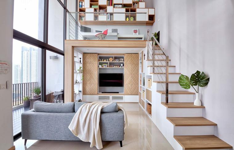 Arredare un open space, appartamento con scale interne, soggiorno con divano grigio in tessuto