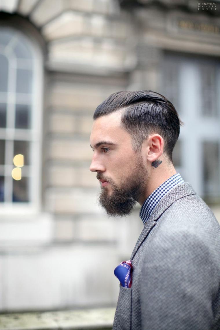 Taglio capelli uomo sfumatura, ragazzo con barba e capelli tagliati corti ai lati